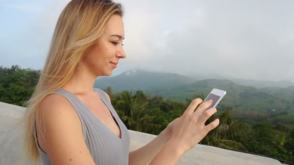 Slow motion photographer young woman using tablet to read comments in social networks.