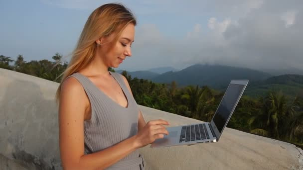 Slow motion business woman working on laptop