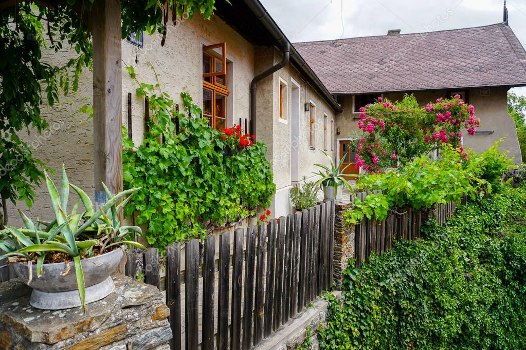 Austrian little rural buildings decorated with plants.