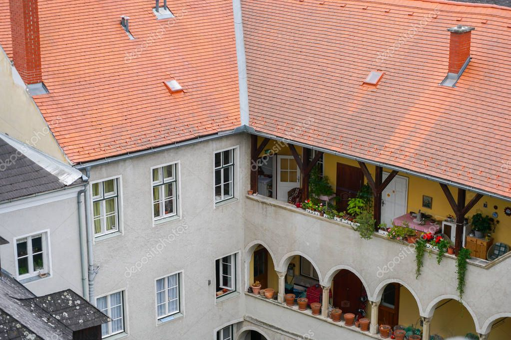 Rooftop image with tiled red roof of building in Autria.