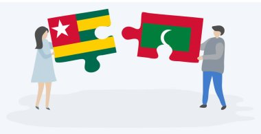 Couple holding two puzzles pieces with Togolese and Maldivian flags. Togo and Maldives national symbols together.