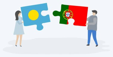 Couple holding two puzzles pieces with Palauan and Portuguese flags. Palau and Portugal national symbols together.