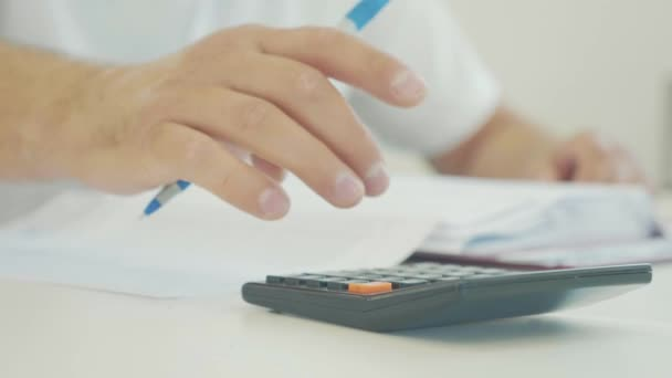 Businessman hand working with finances documents and using calculator in office