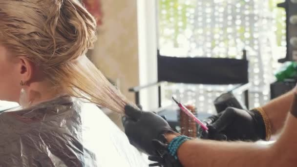 Keratin recovery and protein treatment at beauty spa salon.