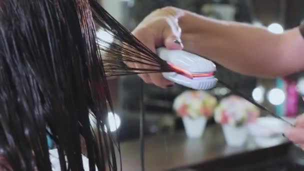 Keratin recovery and protein treatment with professional infrared iron tool.