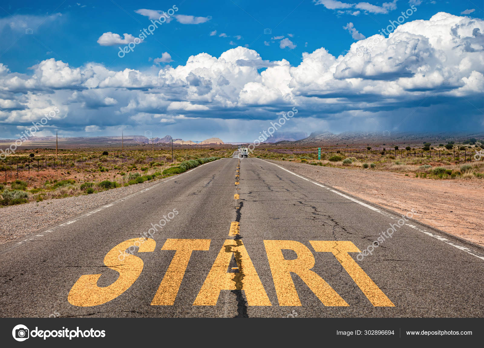 Start concept  Text sign on a long straight road, blue sky
