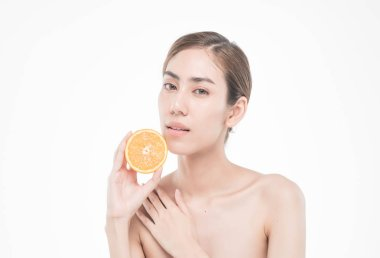 young woman holding juicy oranges . Healthy eating concept. Diet. Isolated over white.