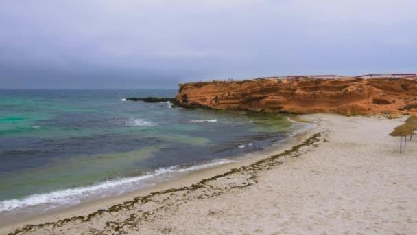 Empty rocky cape with sandy beach near beautiful sea
