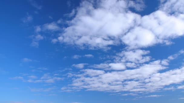 Bright blue sky and white clouds floating away. Clouds flying in clear blue sky