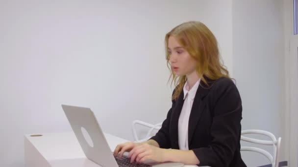 Business woman sitting on workplace using laptop computer for work in office