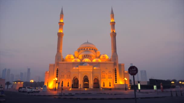 Illuminated mosque at night. Mist and dusk around mosque and gold light of lanterns shine. Islam architecture.