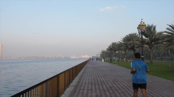 Sharjah, UAE - January 18, 2018: Man runner jogging on morning embankment along Khalid lake trail
