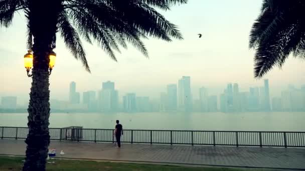 Sharjah, UAE - January 18, 2018: Arab man fishing on evening embankment