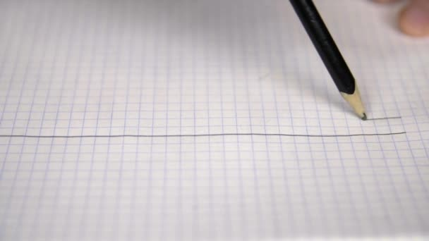 Close up view of person drawing five lines in notepad with pencil for music notes, education concept