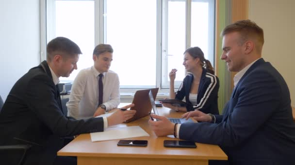 Business team discussing together in conference room during meeting at office