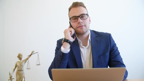 Confident lawyer making consultation by a smartphone.