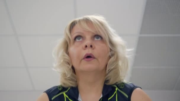 Middle aged woman face during the cardiovascular training.