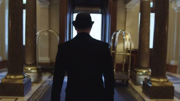 Gentleman walking in a hall of a luxury hotel