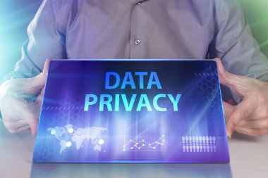 The concept of business, technology, the Internet and the network. A young entrepreneur working on a virtual screen of the future and sees the inscription: Data privacy