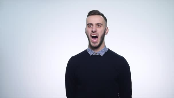 Angry young man On white Background. close up. slow motion