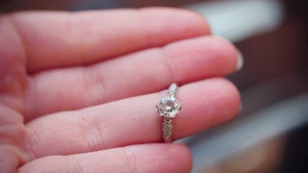 Close up of an elegant diamond ring on finger