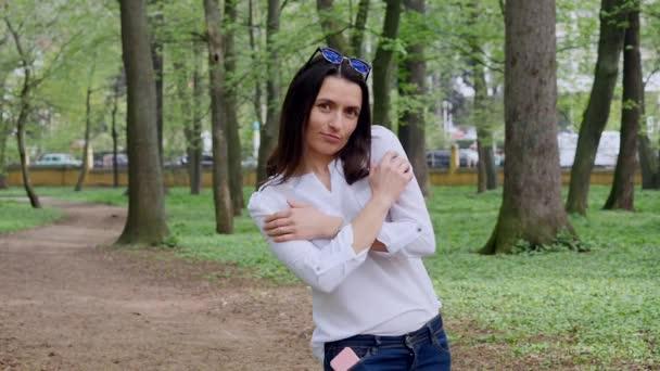Pretty Young Woman Enjoys City Park, Smiles