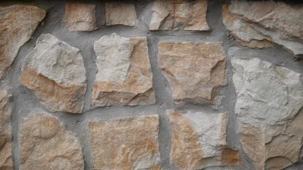 Struktura kamenné zdi. Starý hrad kámen zeď textura pozadí. Kamenná stěna jako pozadí nebo textura. Část kamenné stěny, pro pozadí nebo texturu