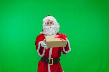 Santa Claus with gift box against chromakey