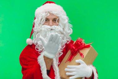 Photo of kind Santa Claus giving xmas present and looking at camera. chroma key