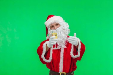 Santa Claus with champagne glass. Santa holding a drink. Chroma key