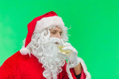 Santa Claus celebrating with champagne. chroma key