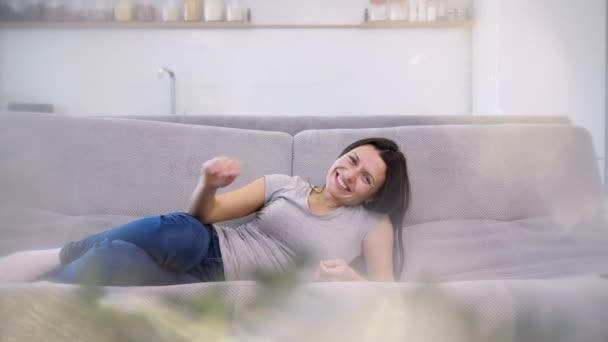 A good woman is spending time on the couch