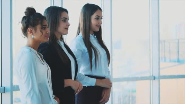 Three hands of girls businessmen close their hands, demonstrating effective integration and success in business.