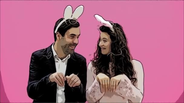 junges sexy Paar auf rosa Hintergrund. mit abgedroschenen Ohren auf dem Kopf. während dieser Fortpflanzung sexuelle Kaninchenbewegungen und Blicke, die nach einer Weile aus dem Rahmen fallen. das Konzept eines schrillen.