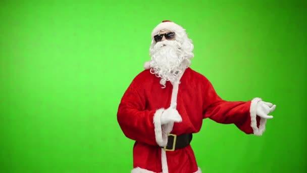 Santa napszemüveg zöld háttér, Chroma key, karácsonyi partin képzeletbeli gitározni