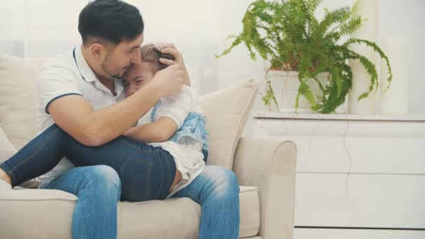 4k slowmotion video where parent solving a problem with his child.