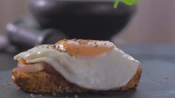 Place basil on sandwich with egg