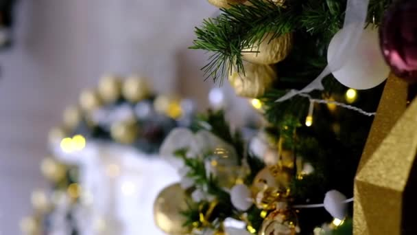 Close Up of golden toys on Chrismas Tree and blinking fairy light on background