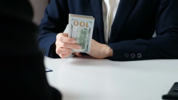Close-up Of Businessperson Taking Bribe From Partner. Corruption concept