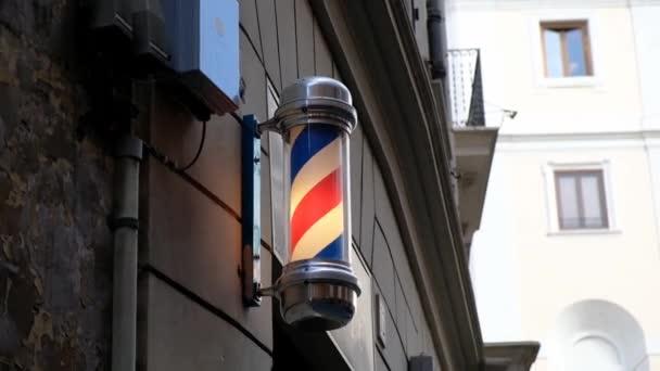 Vintage barbershop and hairdresser symbol. Traditional barber pole rotating in barbershop