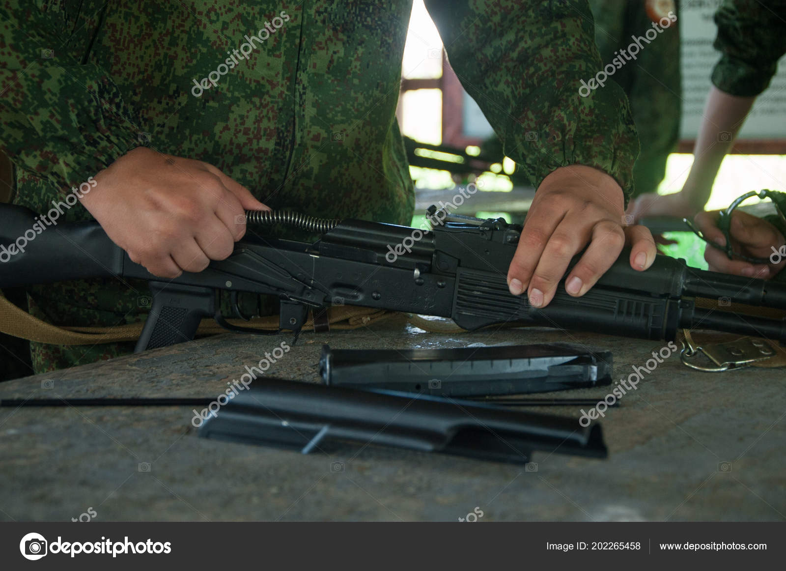 military camp assembling automatic gun stock photo evgenija20071
