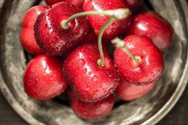 Wet Fresh Red Cherries in Rustic Plate