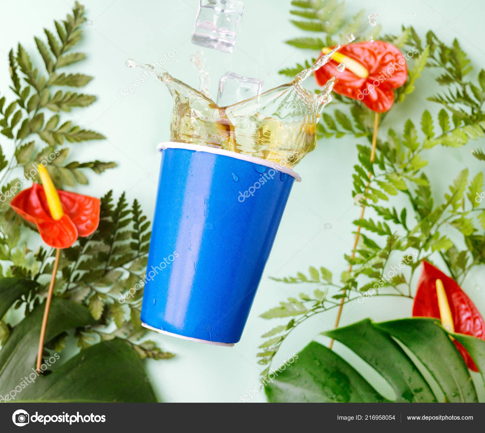 Blue cup tea splashes tropical background red calla anthurium blue cup tea splashes tropical background red calla anthurium flowers izmirmasajfo