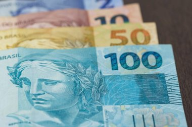 Closeup of varied values of Brazilian money. Economy of Brazil c