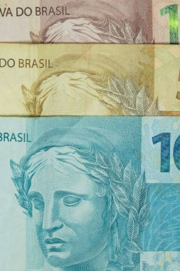 Closeup of varied values of Brazilian money. Economy of Brazil concept image.