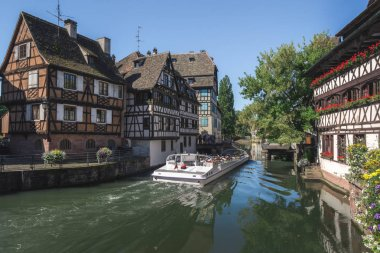 Postcard view of the Petite France, a  famous historical quarter in Strasbourg, France, crossed by the river Ill, used for boat trips around the city.