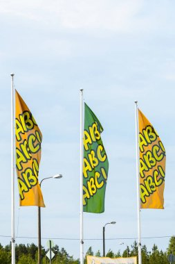 Kouvola, Finland - June 4, 2019: Flags with the logo of ABC. ABC is a brand of automobile fuels and petrol stations and restaurants present in Finland