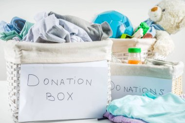 Donation box with clothes, toys and food