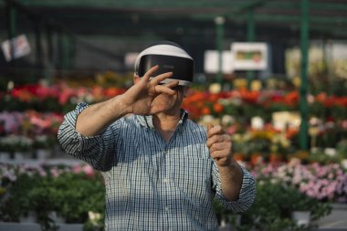 Man with VR glasses in the garden