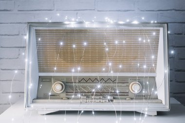 Close-up of a radio with Christmas lights